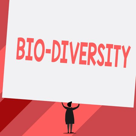 Conceptual hand writing showing Bio Diversity. Concept meaning Variety of Life Organisms Marine Fauna Ecosystem Habitat Short hair woman dress hands up holding blank rectangle Banco de Imagens