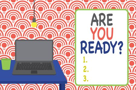 Conceptual hand writing showing Are You Ready Question. Concept meaning Setting oneself on the activity Being Prepared Front view laptop lying on wooden desktop light bulb glass Stock Photo