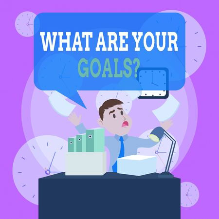 Writing note showing What Are Your Goals Question. Business concept for ask the Desired End Results to know the plans Male Manager Cluttered Workspace Overflow Time Shortage
