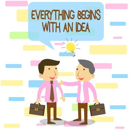 Writing note showing Everything Begins With An Idea. Business concept for steps you take to turn an idea into a reality Two White Businessmen Colleagues with Brief Cases Sharing Idea Solution