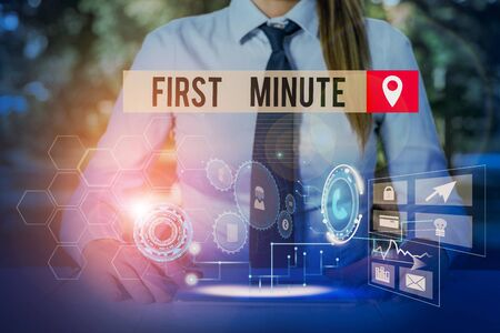 Handwriting text First Minute. Conceptual photo promotional offers last within a very short amount of time Woman wear formal work suit presenting presentation using smart device