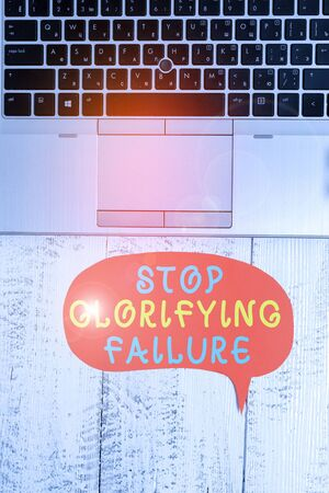 Word writing text Stop Glorifying Failure. Business photo showcasing do not let Breakdown Rule your life Try again Close view open laptop blank speech bubble downwards lying vintage table