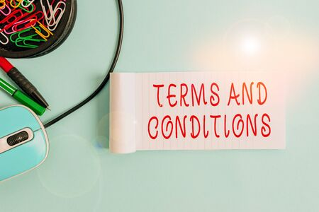 Handwriting text Terms And Conditions. Conceptual photo rules that apply to fulfilling a particular contract Notebook and writing equipment with computer mouse above pastel backdrop