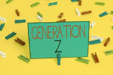 Text sign showing Generation Z. Business photo showcasing name for the generation of children after the millennials Colored clothespin papers empty reminder yellow floor background office
