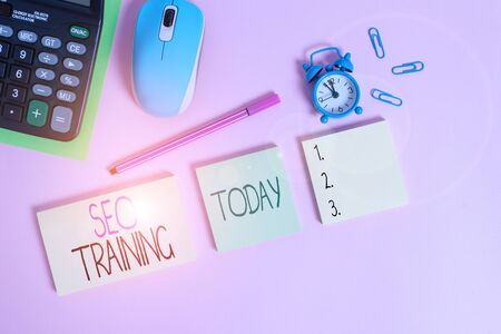 Conceptual hand writing showing Seo Training. Concept meaning learn specific knowledge improve perforanalysisce in current roles Notepads alarm clock calculator sheet marker colored background