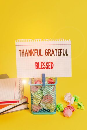 Handwriting text Thankful Grateful Blessed. Conceptual photo Appreciation gratitude good mood attitude Trash bin crumpled paper clothespin empty reminder office supplies yellow Banco de Imagens