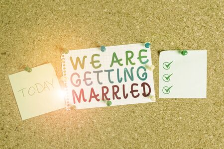 Handwriting text We Are Getting Married. Conceptual photo Engagement Wedding preparation Loving couple Corkboard color size paper pin thumbtack tack sheet billboard notice board