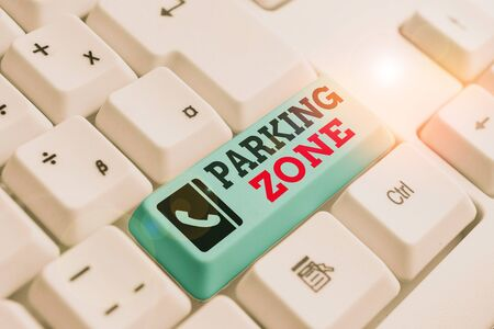Text sign showing Parking Zone. Business photo text a space where an automobile can be parked Allowed to parked White pc keyboard with empty note paper above white background key copy space