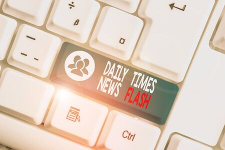 Writing note showing Daily Times News Flash. Business concept for fast response to actions happened in article way White pc keyboard with note paper above the white background