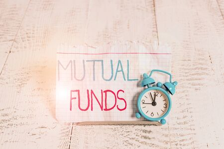 Writing note showing Mutual Funds. Business concept for collection of stocks bonds or other securities from investors