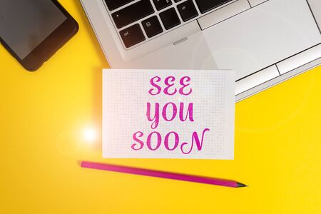 Text sign showing See You Soon. Business photo text used for saying goodbye to someone and going to meet again soon Metallic laptop pencil squared paper sheet smartphone colored background