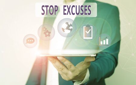 Handwriting text writing Stop Excuses. Conceptual photo put an end to an explanation for something that went wrong Male human wear formal work suit presenting presentation using smart device