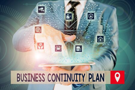 Handwriting text writing Business Continuity Plan. Conceptual photo creating systems prevention deal potential threats Male human wear formal work suit presenting presentation using smart device