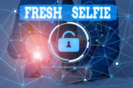 Text sign showing Fresh Selfie. Business photo showcasing take a picture of yourself with no makeup filter or edit Male human wear formal work suit presenting presentation using smart device