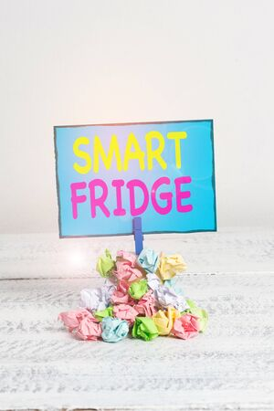 Text sign showing Smart Fridge. Business photo showcasing programmed to sense what kinds of products being stored inside Reminder pile colored crumpled paper clothespin reminder white wooden space