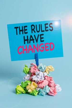Text sign showing The Rules Have Changed. Business photo text the agreement or Policy has a new set of comanalysisds Reminder pile colored crumpled paper clothespin reminder blue background