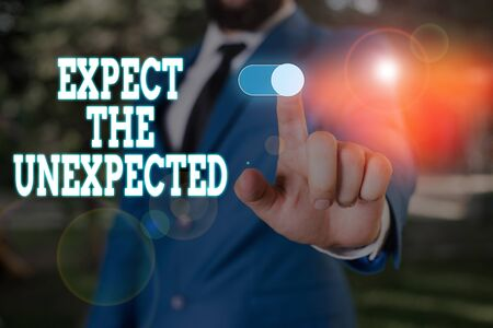 Text sign showing Expect The Unexpected. Business photo text Anything can Happen Consider all Possible Events Male human wear formal work suit presenting presentation using smart device