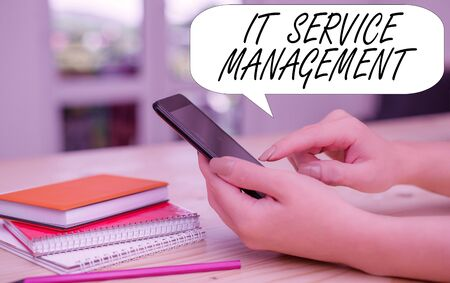Conceptual hand writing showing It Service Management. Concept meaning Activity Directed by Policies Lifecycle of Technology woman using smartphone and technological devices inside the home