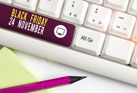Writing note showing Black Friday 24 November. Business concept for Special sales Thanksgiving discounts Clearance White pc keyboard with note paper above the white background