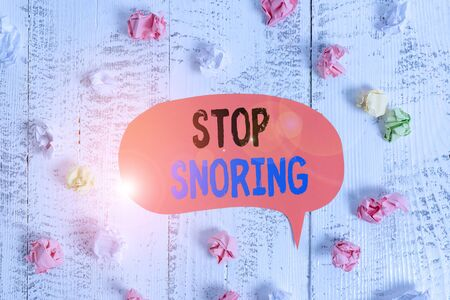 Conceptual hand writing showing Stop Snoring. Concept meaning noisy breathing during sleep due to vibrating airway tissue Colored speech bubble paper balls wooden rustic vintage background Stok Fotoğraf