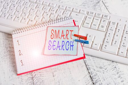 Conceptual hand writing showing Smart Search. Concept meaning tool used in recording software for searching based on motion notebook reminder clothespin with pinned sheet light wooden Standard-Bild