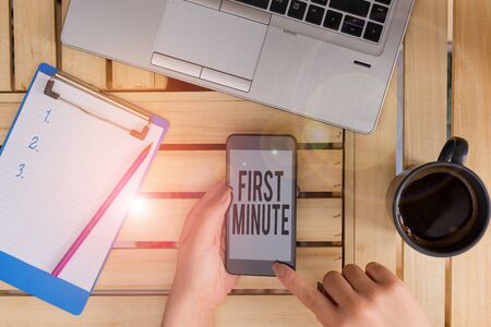 Conceptual hand writing showing First Minute. Concept meaning promotional offers last within a very short amount of time woman with laptop smartphone and office supplies technology Banco de Imagens