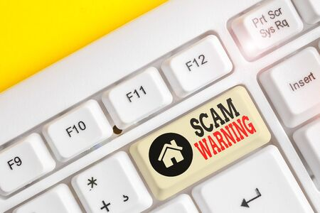 Text sign showing Scam Warning. Business photo text caution of unsolicited email claims the prospect of a bargain White pc keyboard with empty note paper above white background key copy space