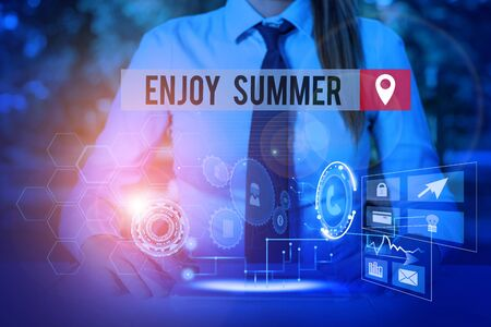 Handwriting text Enjoy Summer. Conceptual photo taking a break from school and spending holidays in the beach Woman wear formal work suit presenting presentation using smart device