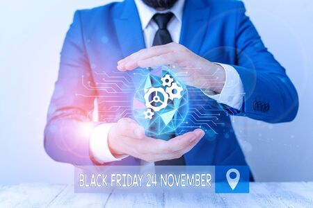 Conceptual hand writing showing Black Friday 24 November. Concept meaning Special sales Thanksgiving discounts Clearance Male human wear formal suit presenting using smart device