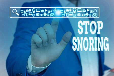 Handwriting text Stop Snoring. Conceptual photo noisy breathing during sleep due to vibrating airway tissue Male human wear formal work suit presenting presentation using smart device
