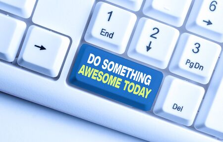 Handwriting text Do Something Awesome Today. Conceptual photo Make an incredible action motivate yourself White pc keyboard with empty note paper above white background key copy space