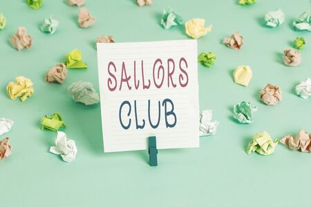 Conceptual hand writing showing Sailors Club. Concept meaning an organization constituted to a demonstrating who goes sailing Colored crumpled papers empty reminder blue floor clothespin