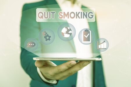 Writing note showing Quit Smoking. Business concept for process of discontinuing tobacco smoking or cessation Male human wear formal suit presenting using smart device Stock Photo