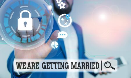 Text sign showing We Are Getting Married. Business photo text Engagement Wedding preparation Loving couple Male human wear formal work suit presenting presentation using smart device