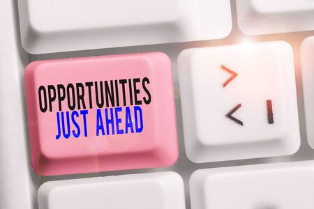 Writing note showing Opportunities Just Ahead. Business concept for Advantageous circumstances Perseverance pays off Keyboard with note paper on white background key copy space