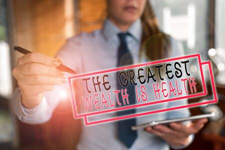 Text sign showing The Greatest Wealth Is Health. Business photo text being in good health is the prize Take care Blurred woman in the background pointing with finger in empty space