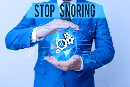 Conceptual hand writing showing Stop Snoring. Concept meaning noisy breathing during sleep due to vibrating airway tissue Male human wear formal suit presenting using smart device