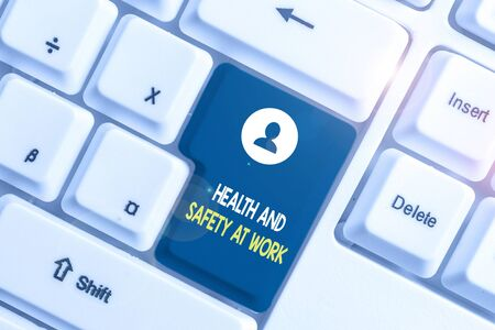 Text sign showing Health And Safety At Work. Business photo showcasing Secure procedures prevent accidents avoid danger White pc keyboard with empty note paper above white background key copy space