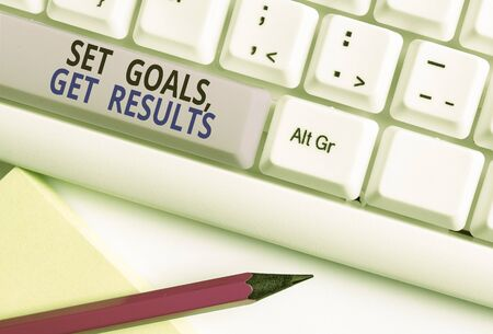 Text sign showing Set Goals Get Results. Business photo showcasing Establish objectives work for accomplish them White pc keyboard with empty note paper above white background key copy space