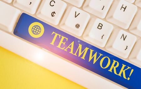 Text sign showing Teamwork. Business photo showcasing combined action of group especially when effective and efficient White pc keyboard with empty note paper above white background key copy space