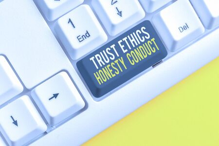 Conceptual hand writing showing Trust Ethics Honesty Conduct. Concept meaning connotes positive and virtuous attributes White pc keyboard with note paper above the white background