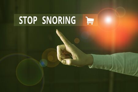 Word writing text Stop Snoring. Business photo showcasing noisy breathing during sleep due to vibrating airway tissue Finger pointing in the Dark with hand pointing in the copy space