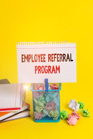 Handwriting text Employee Referral Program. Conceptual photo employees recommend qualified friends relatives Trash bin crumpled paper clothespin empty reminder office supplies yellow Stock Photo