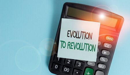 Text sign showing Evolution To Revolution. Business photo showcasing adapting to way of living for creatures and huanalysiss Portable electronic calculator device blank sticky note colored background Stockfoto