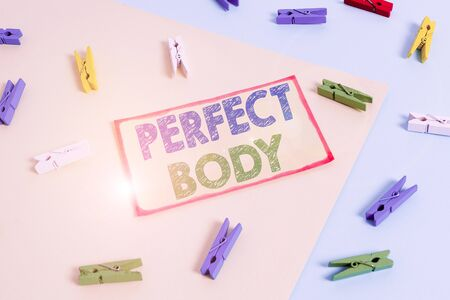 Writing note showing Perfect Body. Business concept for Having a body that is dreamily in shape and in healthy state Colored clothespin paper reminder with yellow blue background Фото со стока