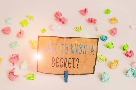 Text sign showing Want To Know A Secret Question. Business photo text to divulge a confidential vital information Colored crumpled papers empty reminder white floor background clothespin