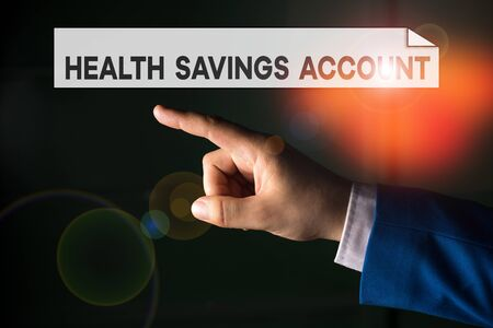 Writing note showing Health Savings Account. Business concept for users with High Deductible Health Insurance Policy Isolated hand pointing with finger. Business concept pointing finger Zdjęcie Seryjne