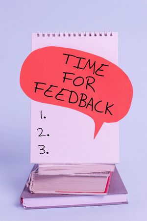 Writing note showing Time For Feedback. Business concept for information about reactions to a product or services Spiral notebook speech bubble stacked old books cool pastel background 写真素材