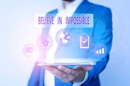Conceptual hand writing showing Believe In Impossible. Concept meaning You can do it everything is possible Work hard Male human wear formal suit presenting using smart device