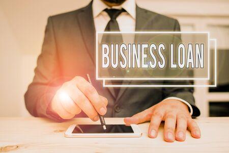 Handwriting text writing Business Loan. Conceptual photo Credit Mortgage Financial Assistance Cash Advances Debt Banco de Imagens - 131344869